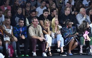 NEW YORK, NY - OCTOBER 19: Cole Whittle, Joe Jonas, Spike Jonze, Sienna Miller, Lupita Nyong'o and Charli XCX sit front row at KENZO x H&M Launch Event Directed By Jean-Paul Goude' at Pier 36 on October 19, 2016 in New York City. (Photo by Dimitrios Kambouris/Getty Images for H&M)
